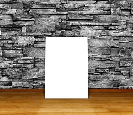 Poster standing on laminate flooring with granite stone wall. write text on paper for advertise or public relations