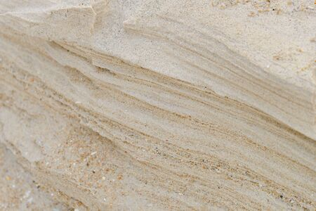 Layers of sand on the beach, soft sandstone at the shore. Abstract background texture Stockfoto