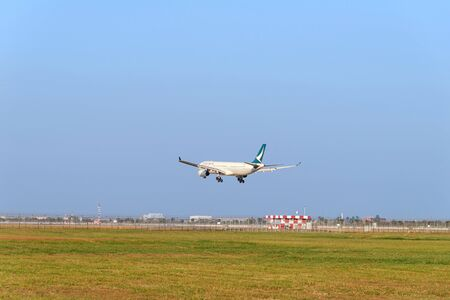 Samut Prakan, THAILAND - December 30, 2019: Airplane of Cathay Pacific airlines on approach for landing at Suvarnabhumi International Airport, THAILAND