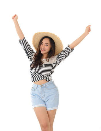 portrait of happy young asian female smiling wearing straw hat and summer dress isolated on white background. Leisure amd summer travel concept