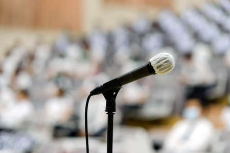 Close up of microphone over abstract blurred of attendee in seminar room or conference hall 版權商用圖片