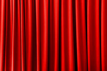 Red curtain with light and shadows for texture or background Stock Photo