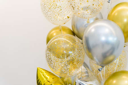 Golden and Silver colour balloons on white background with copy space for party decoration, New Year concept. celebrate time