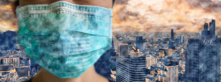 Asian woman wear face mask to protect PM 2.5 dust and air pollution with cityscape on background. Girl in medical mask protect of air pollution and virus epidemic . Banner panorama and copy space