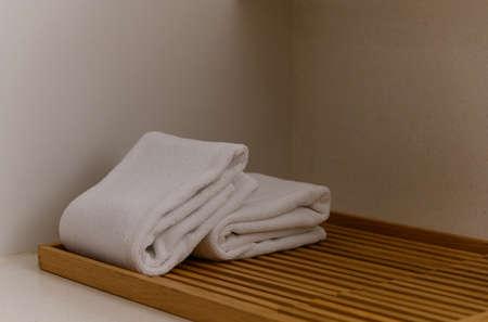 white towel on wooden board in bathroom. hygiene, shower, bath, freshness concept