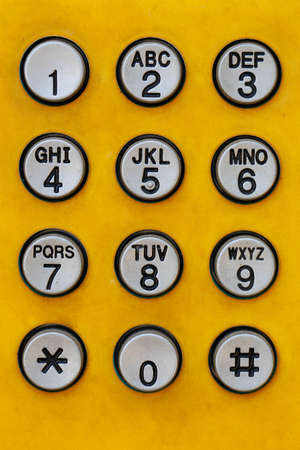 dial pad: telephone keys number on yellow  Stock Photo