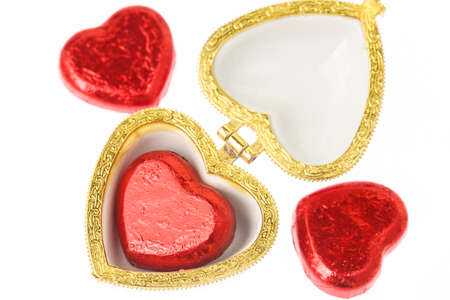 Red and gold chocolate hearts candies on white is gift for valentine day photo