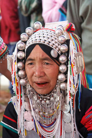 CHIANG MAI, THAILAND - FEB  4 : Unidentified  hill tribe was waitting for health service  with traditional clothes and silver jewelery at  Ban muang-ngam on january 27, 2014 in Chiang Mai, Thailand.
