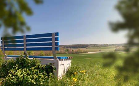 park bench to relax in old age. place to rest in spring with sunshine and green meadows. peaceful environment