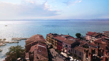 Italian town of Sirmione on Lake Garda from above. Italian houses with a view from above nice Фото со стока