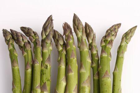 Green asparagus on white