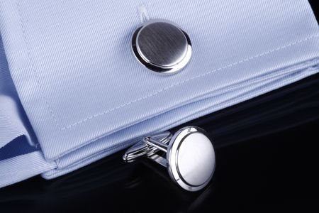 french cuffs: Cufflinks on business shirt Stock Photo