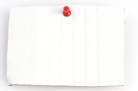 withe cardboard with red thumbtack and space for copy Stock Photo