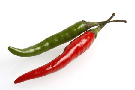 two hot chilies on white Stock Photo