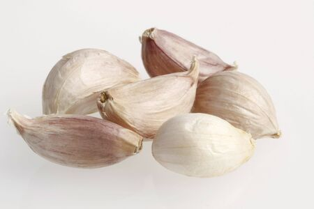 Garlic cloves on white