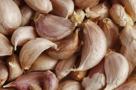 Garlic cloves background Stock Photo
