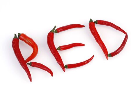 Chilis arranged to form the word RED Stock Photo