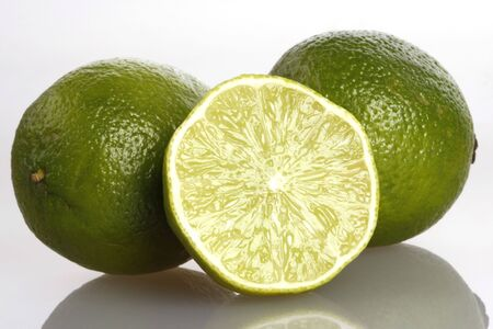 Three Limes on reflective background