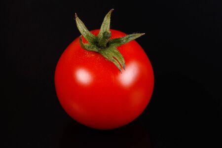 Tomato on black background Stock Photo