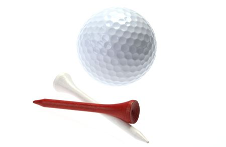 Golf ball with two tees on white