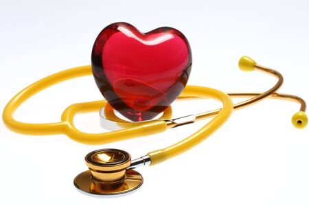 Stethoscope with red glass heart Stock Photo