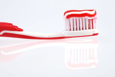 Toothbrush with toothpaste and reflection