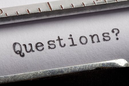Questions written on an old typewriter Stock Photo - 5140446