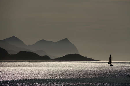 Sailboat cruising between the island of Sejna and Vesteralen in Nordland in Norway