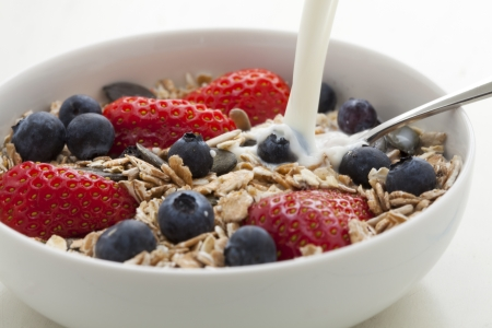 cereal bowl: Fresh Muesli with strawberries, blueberries, pumpkin seeds, cereals and milk