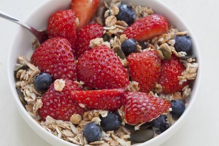 Fresh Muesli with strawberries, blueberries, pumpkin seeds, cereals and milk