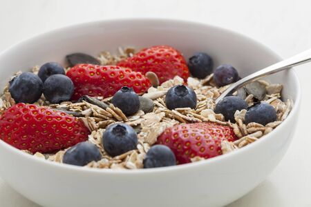 Fresh Muesli with strawberries, blueberries, pumpkin seeds, cereals Stock Photo