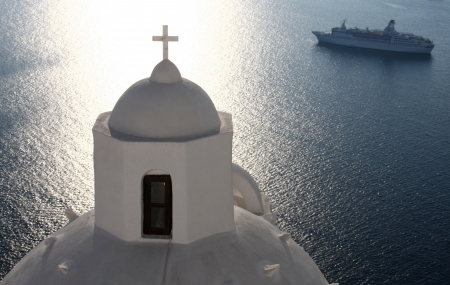 Greek Orthodox church on Santorini with cruise ship in background