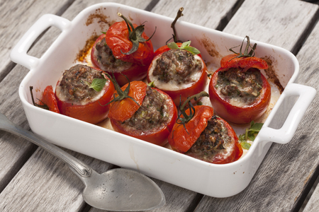 Tomatoes stuffed with herbs, spices and minced meat and baked in the oven