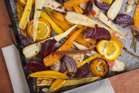 root vegetables baked in the oven with olive oil and spices and herbs