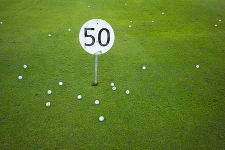 A fifty yards or meter sign on a golf driving range - concept for the number 50