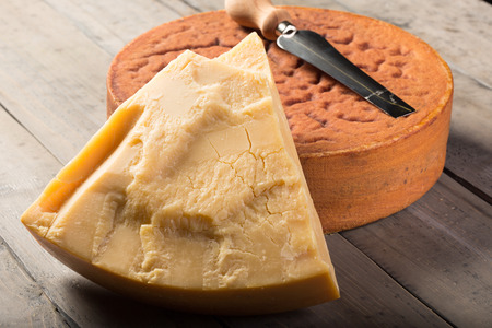 Ripe Swiss Sbrinz cheese on wooden table Stock Photo - 37625073