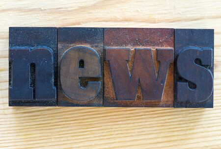 News written with old-fashioned wooden letters