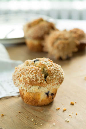 Blueberry muffin on old wooden table Stock Photo