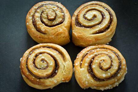 Cinnamon buns on rustic baking plate Stock Photo