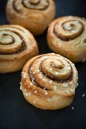 Cinnamon buns on rustic baking plate Stock Photo - 39791184