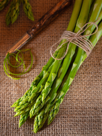 green asparagus on a rustic background