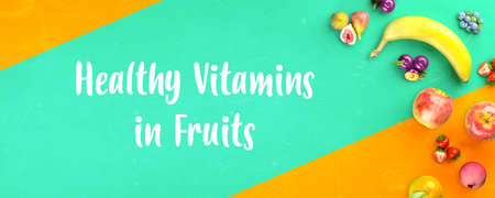 Healthy fruits with vitamins background. Organic fresh sweet fruits banner. Apples, banana, orange, plums, strawberies. Healthy diet. 3d rendering.