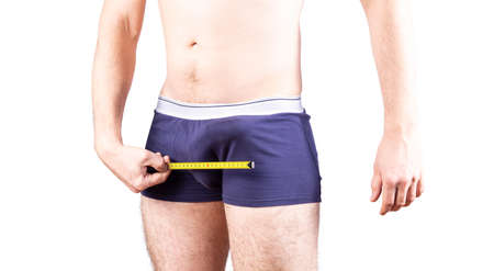 Penis size measure concept. Man measures his penis in underwear. Erectile and potency concept.