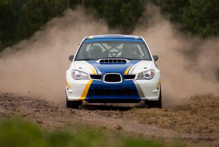 mud slide: Rally car in action - Subaru Impreza