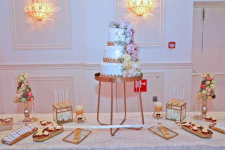 Dessert table for a party,Beautiflu wedding cake at wedding party at night Stock fotó