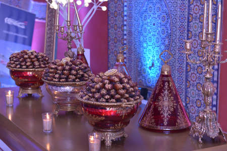 Dates in saucers above the buffet table. Moroccan wedding preparations