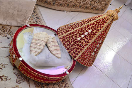 Moroccan Tyafer, traditional gift containers for the wedding ceremony, decorated with ornate golden embroidery.Moroccan henna .wedding gifts for the bride