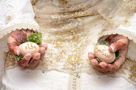 Moroccan wedding. Henna rituals in Morocco. Where the hen's egg is used to bring good luck