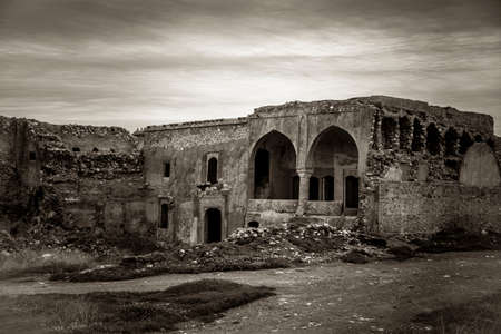 decorative balconies: Ancient Church over an abandoned castle in Iraq
