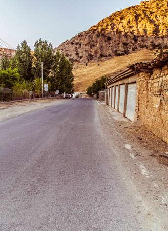 iraqi: Iraqi countryside in Fall season near Erbil city, road to mountain in sunrise